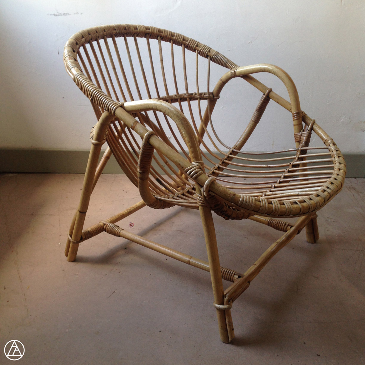 fauteuil coquille rotin